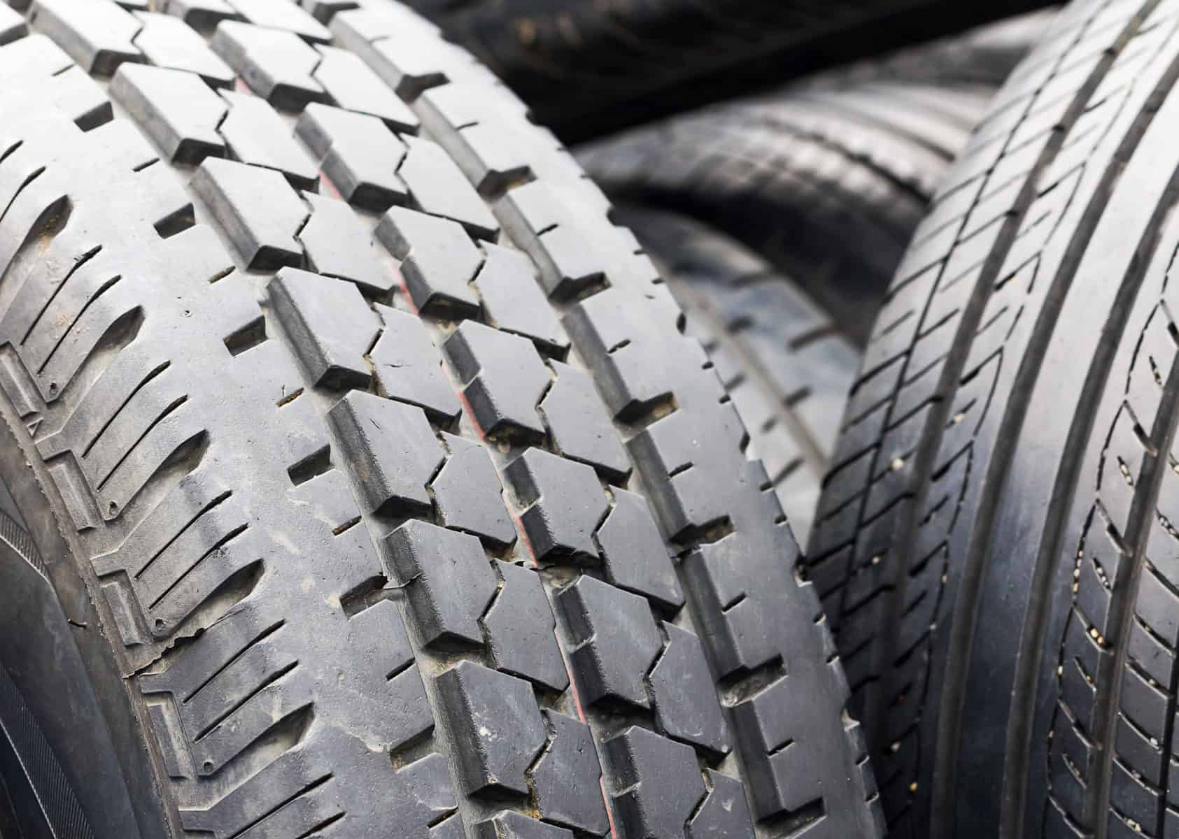 Close up old tires in the tire repair shop yard